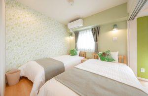 浦添 ホテル ベッドルーム